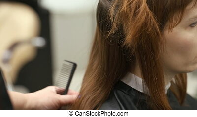 Young woman at hairdressing saloon