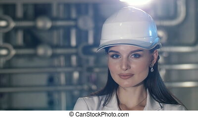 Young woman at helmet - Portrait of a beutiful woman at hard...