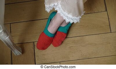 Young woman at home in socks.