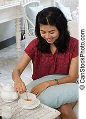 Young woman at home with a tea