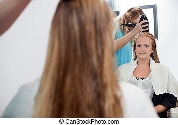 Young Woman At Parlor - Mirror reflection of beautician ...