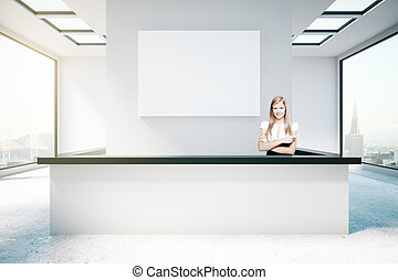 Young woman at reception desk - Young woman at modern...