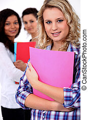 Young woman at school with her friends