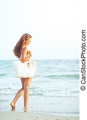Young woman at seaside in the evening
