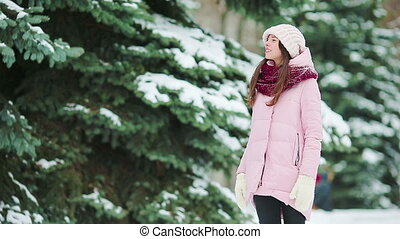 Young woman at snow weather outdoors on beautiful winter day