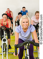 Young woman at spinning class enjoy workout - Young happy...