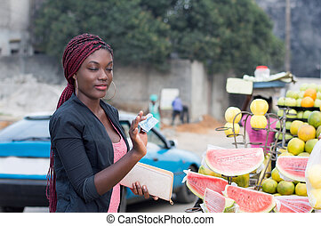 young woman at street fruit market.