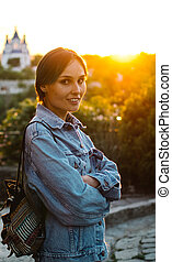 Young woman at sunset. Portrait.