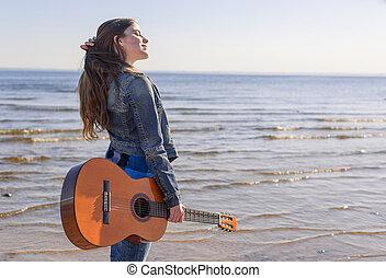 Young woman at the coast
