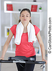 young woman at the gym running on a machine