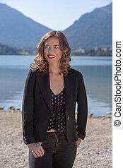 Young woman at the lake