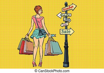 young woman at the sign for sales