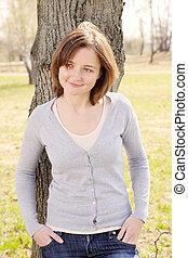 Young woman at tree