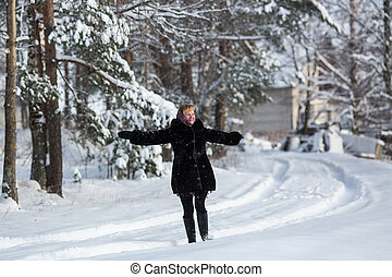 Young woman at winter in the snowy russian village.