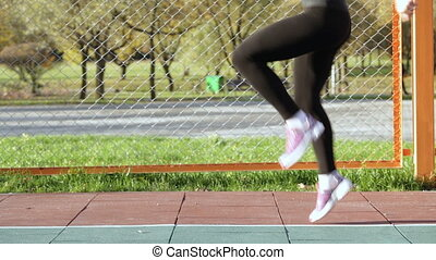 woman athlete doing running raising the knees high