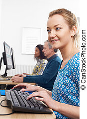 Young Woman Attending Computer Class