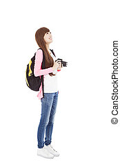 young woman backpacker holding a camera