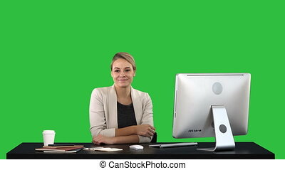 Young woman beauty looking and smiling to camera on a Green Screen, Chroma Key.