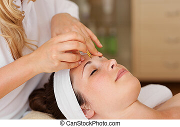 Young woman being pampered in a spa