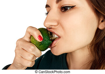 Young woman bite eat fresh lime isolated on a white background