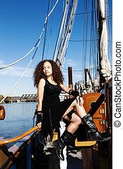 Young Woman Black Dress Sitting On Rail Tall Ship
