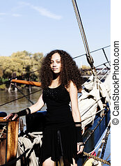 Young Woman Black Dress Standing On Bow Sailing Ship