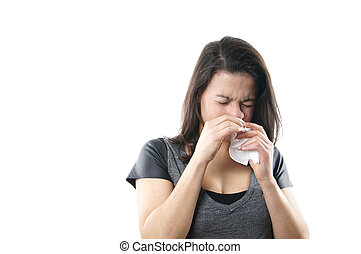 young woman blowing nose with paper tissue