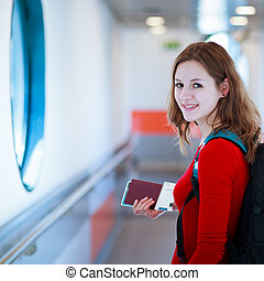 young woman  boarding an aircraft