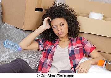 young woman bored with moving