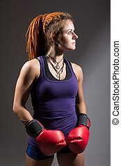 Young woman boxer with dreadlocks