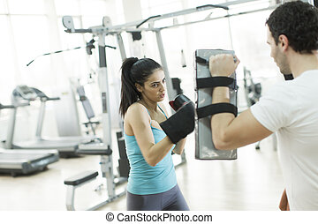 Young woman boxing in the gym