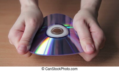 Young Woman Breaking CD, DVD HD