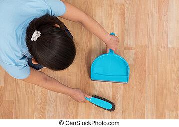Woman Brooming Wooden Floor