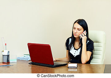 young woman busy with work in office