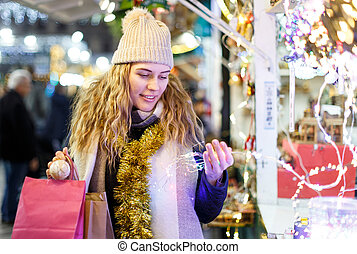 Young woman buying Christmas decorations