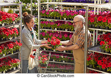 Young Woman Buying Flowers at Plantation