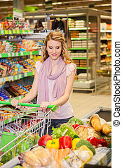 Young woman buying food at the grocery store