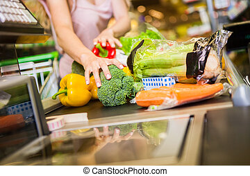 woman buying food at the grocery store