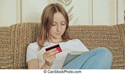 Young woman buying on internet