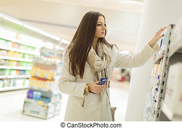 Young woman buying personal care products