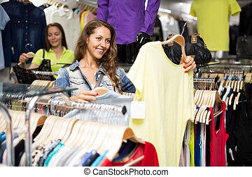 woman buying shirt