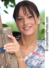 Young woman by a country stile