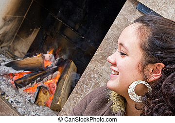 Young woman by the fire