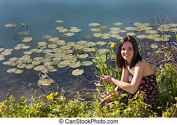 Young woman by the pond