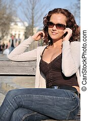 Young woman calling with mobile phone outdoors