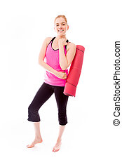 Young woman carrying exercise mat smiling - Young adult...