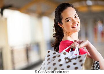 young woman carrying shopping bags