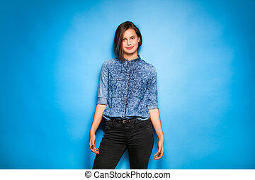 young woman casual dressed on blue background
