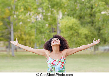 Young woman celebrating her freedom in nature