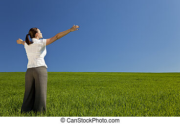 Young Woman Celebrating In A Green Field - A beautiful young...